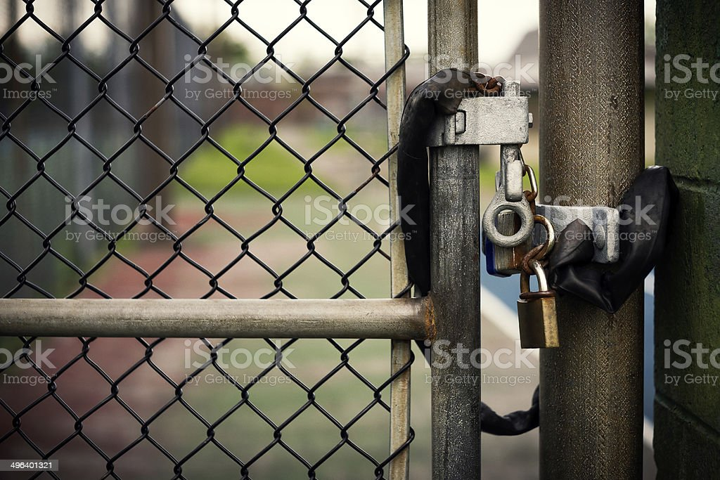 Padlock on a Chain-link Gate stock photo