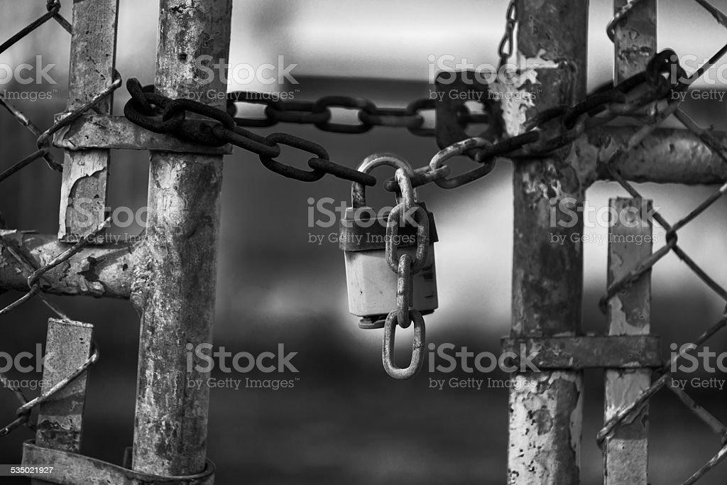 Padlock on Abandoned Factory Gate stock photo