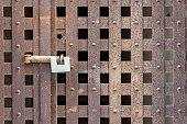 Padlock on an iron door