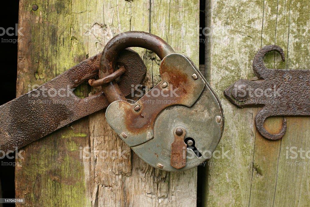 Padlock on an old door royalty-free stock photo