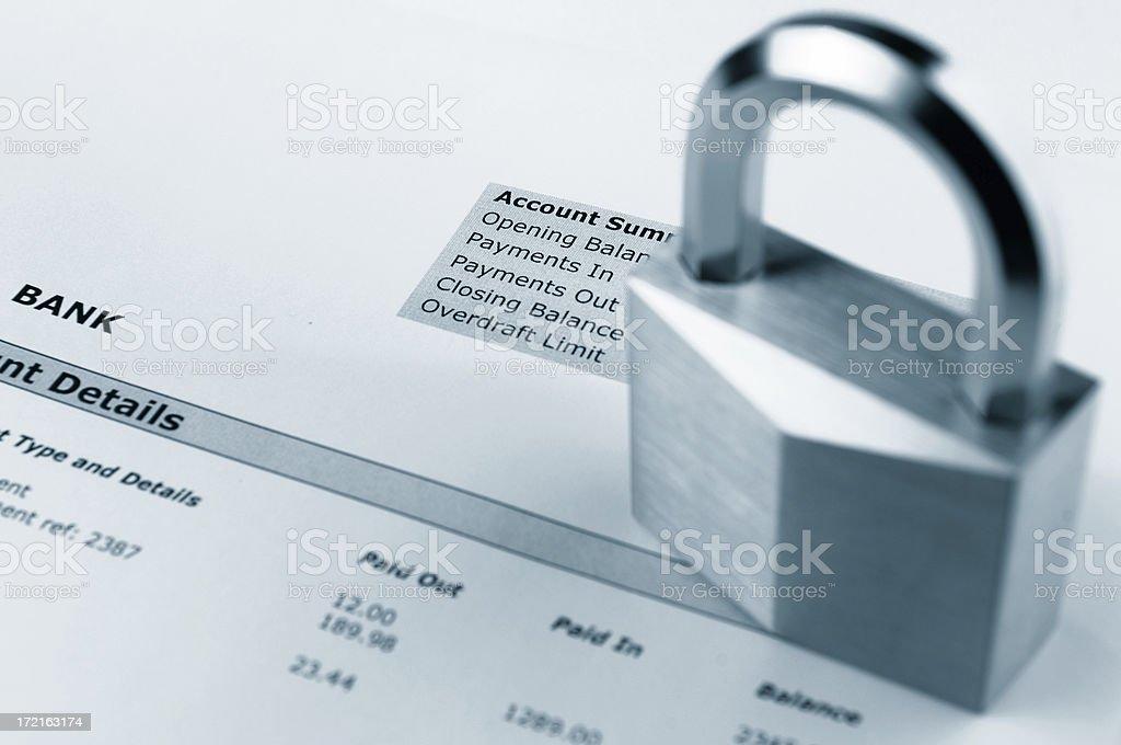 padlock on bank statement stock photo