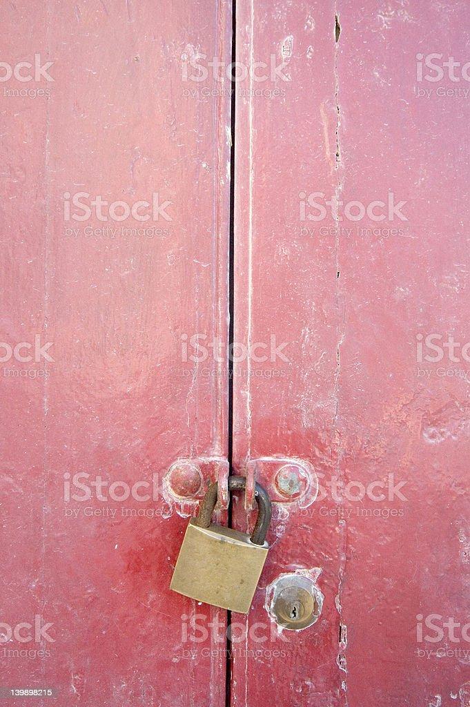 Padlock on gate stock photo