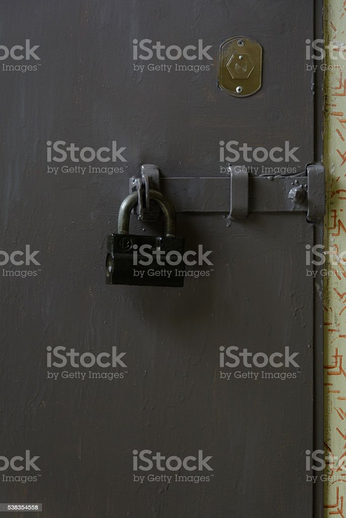 padlock on gray door stock photo