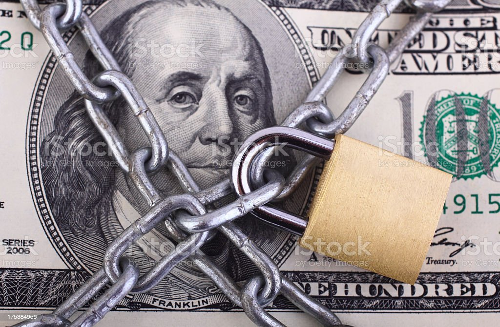 Padlock on hundred dollar bill royalty-free stock photo