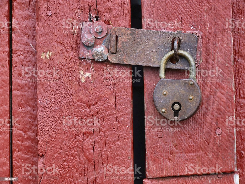 Padlock on old red wooden door royalty-free stock photo