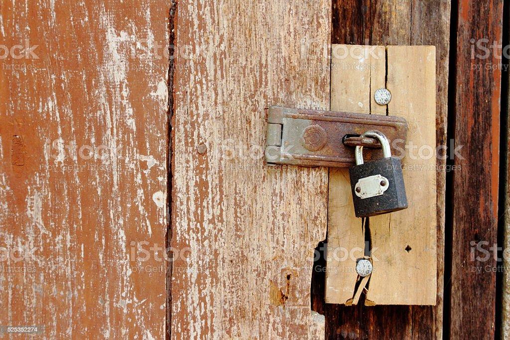 padlock on old wooden door stock photo