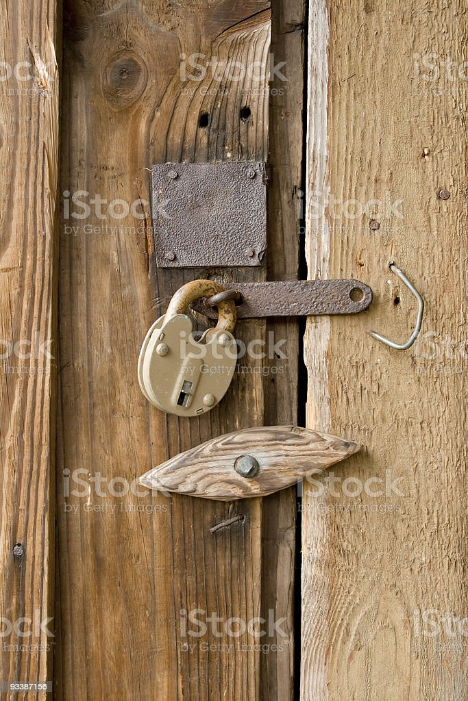 Padlock on the door. royalty-free stock photo