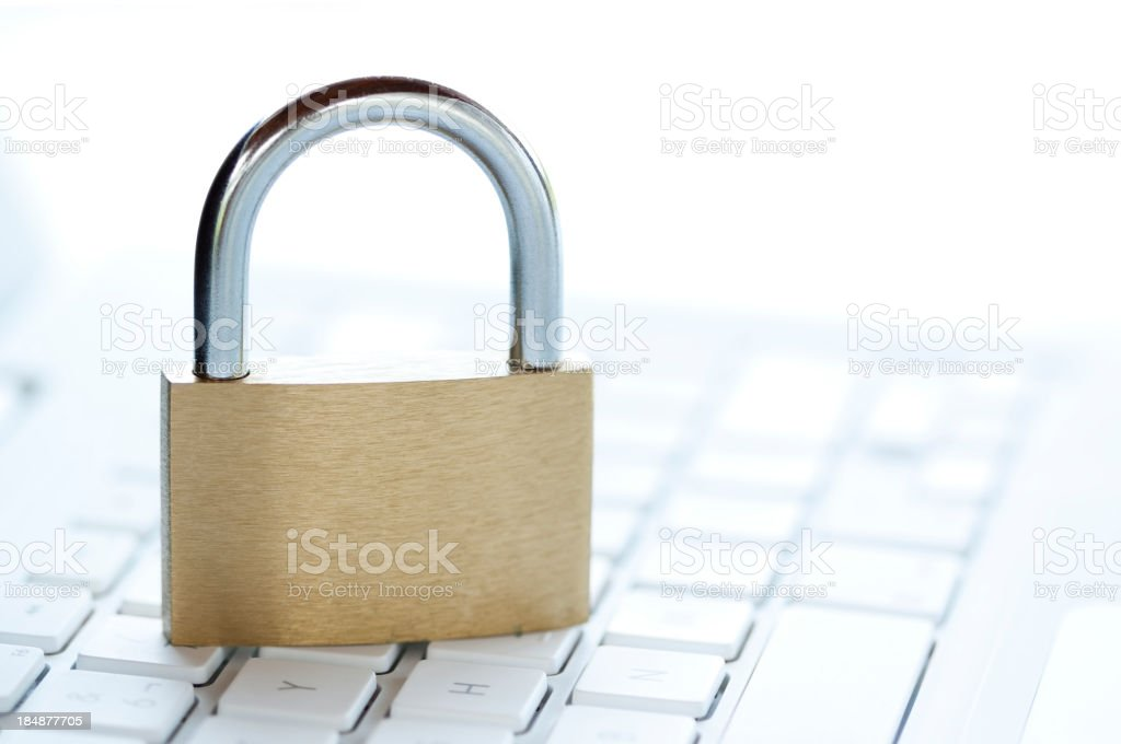 Padlock on white computer keyboard royalty-free stock photo