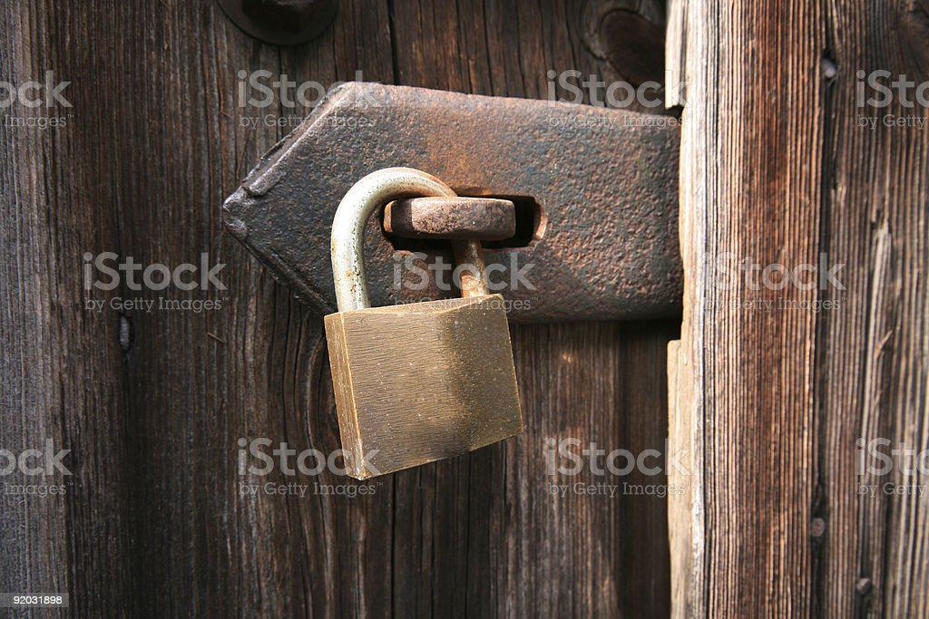 Padlock securing old shed royalty-free stock photo