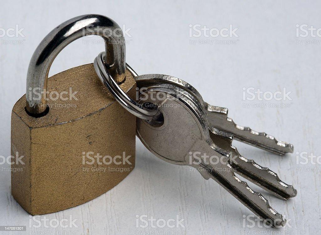 padlock with 3 keys royalty-free stock photo