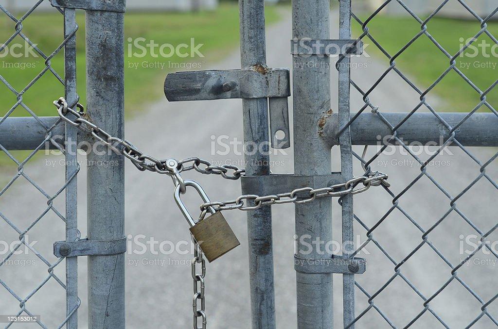 Padlocked fence stock photo