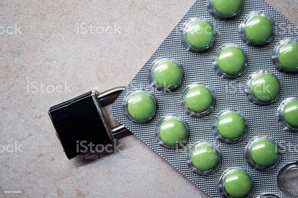 Padlock/Lock on Pill/Tablet Packaging royalty-free stock photo