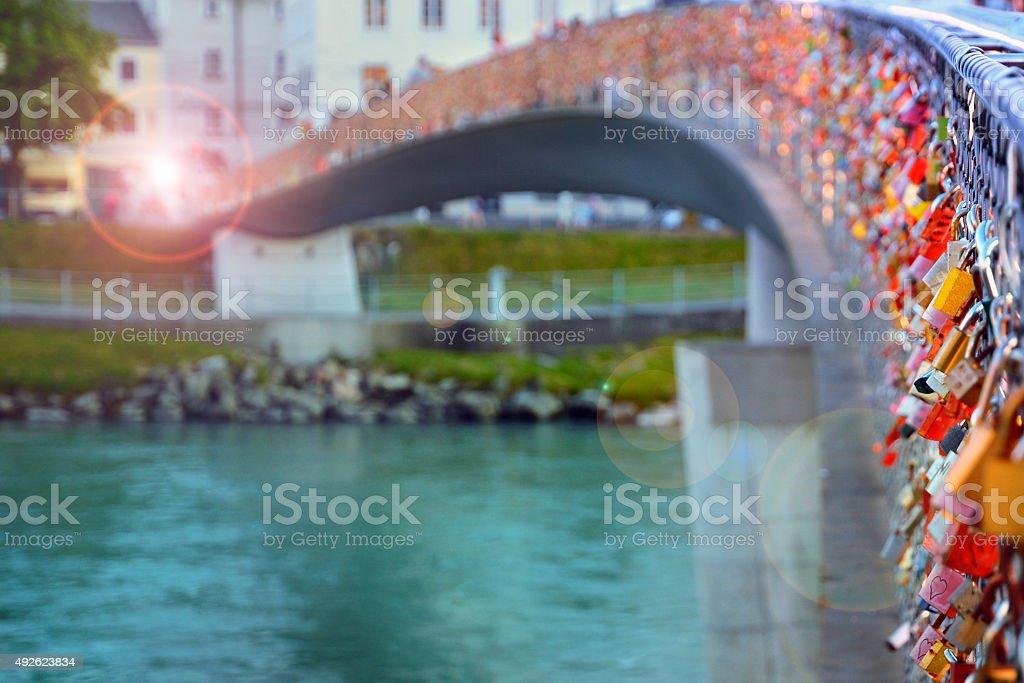 Padlocks of love on a bridge stock photo