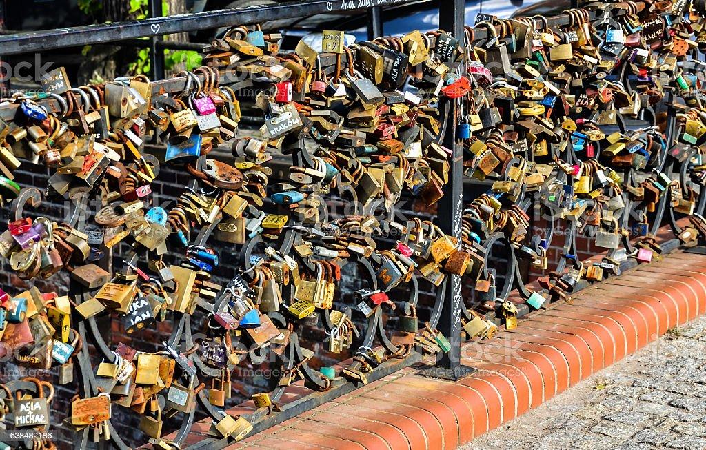 Padlocks of love on bridge stock photo