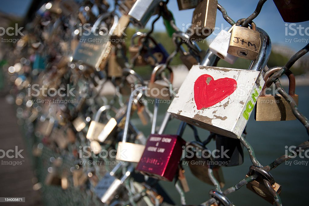 Padlocks on a fence to indicate love will last forever stock photo