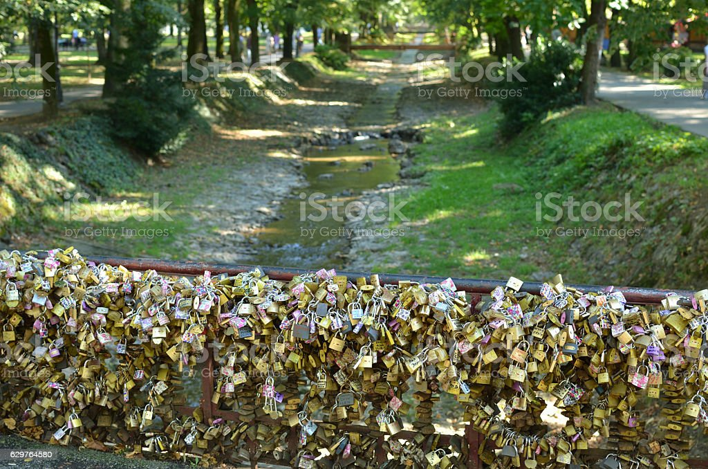 Padlocks on Bridge of Love and Rivulet stock photo