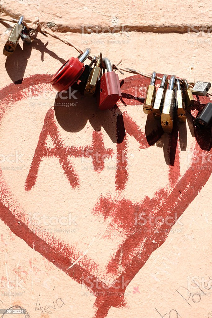 Padlocks on wire with painted heart stock photo