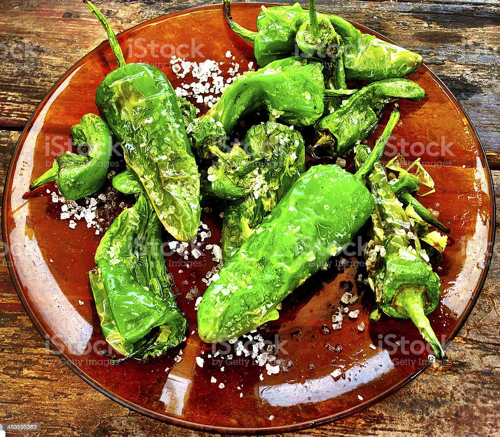 Padron peppers served on a plate royalty-free stock photo