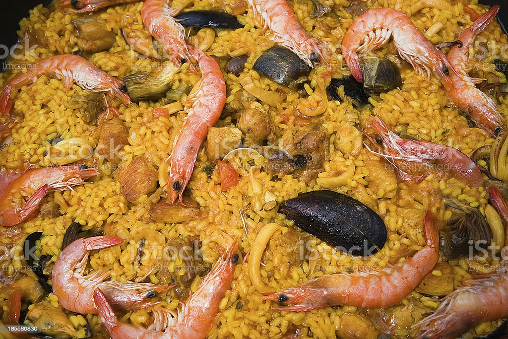 Paella with prawns and mussels, typical Spanish dish royalty-free stock photo