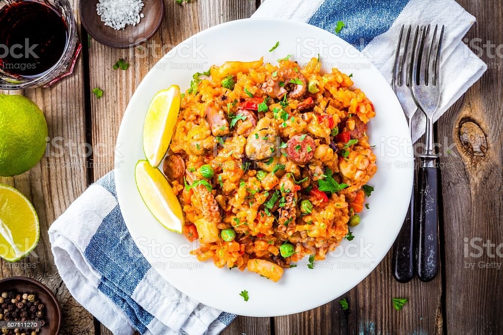Paella with seafood and chorizo sausages stock photo
