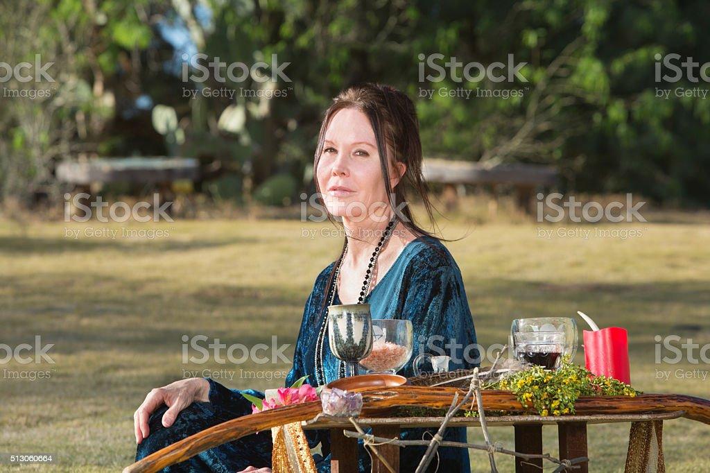 Pagan Woman Sitting Outdoors stock photo