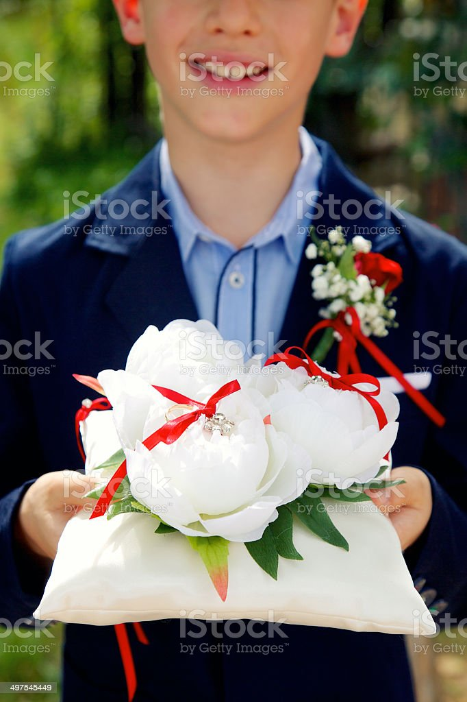 Page boy holding wedding rings royalty-free stock photo