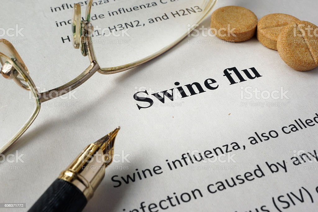 Page of hospital form with diagnosis swine flu and glasses. stock photo