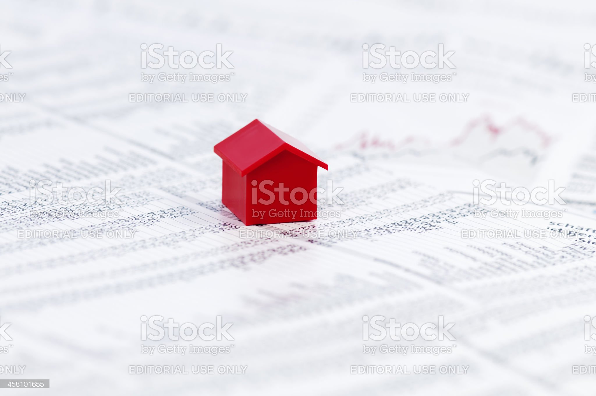 Page of stock market prices with red model house royalty-free stock photo