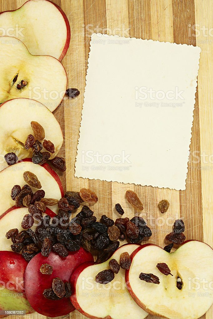 Page with apples and raisin royalty-free stock photo