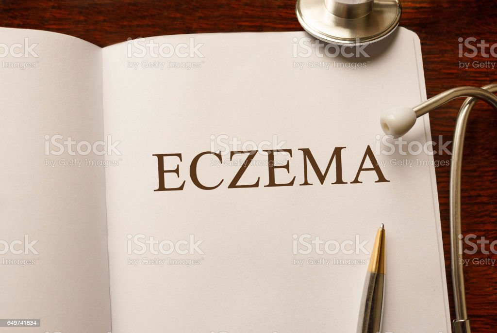 Page with Eczema on the table with stethoscope, medical concept stock photo