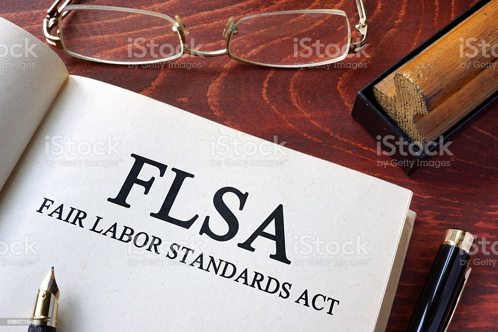 Page with FLSA fair labor standards act on a table. stock photo