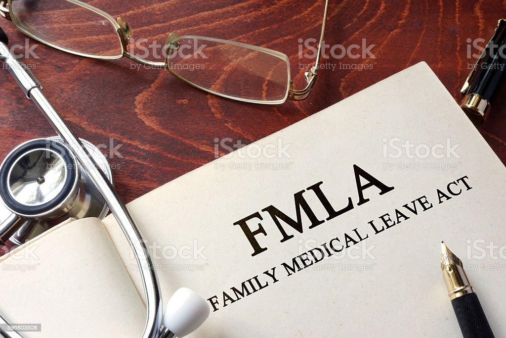 Page with FMLA family medical leave act on a table. stock photo