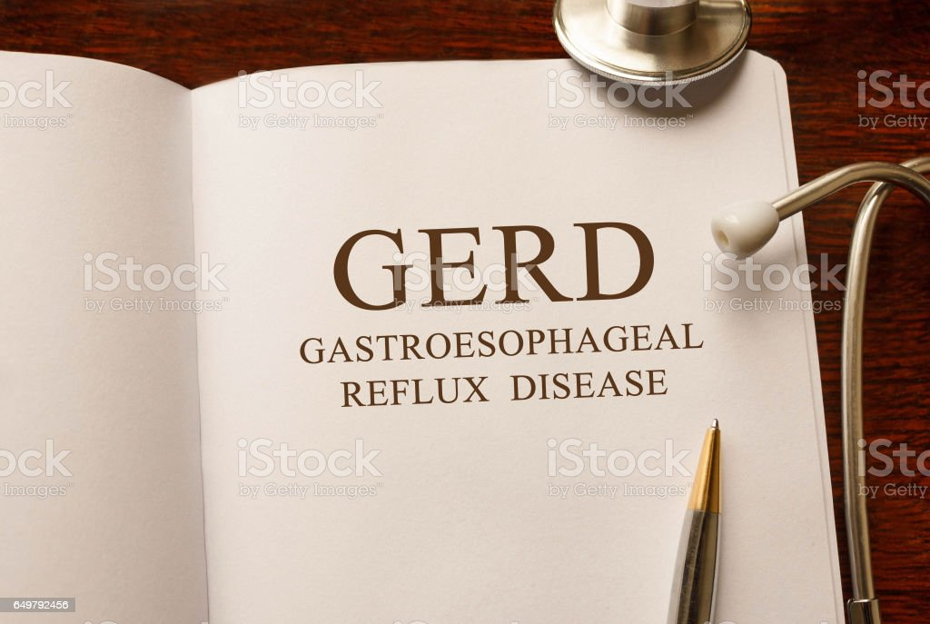 Page with GERD Gastroesophageal Reflux Disease on the table with stethoscope, medical concept stock photo