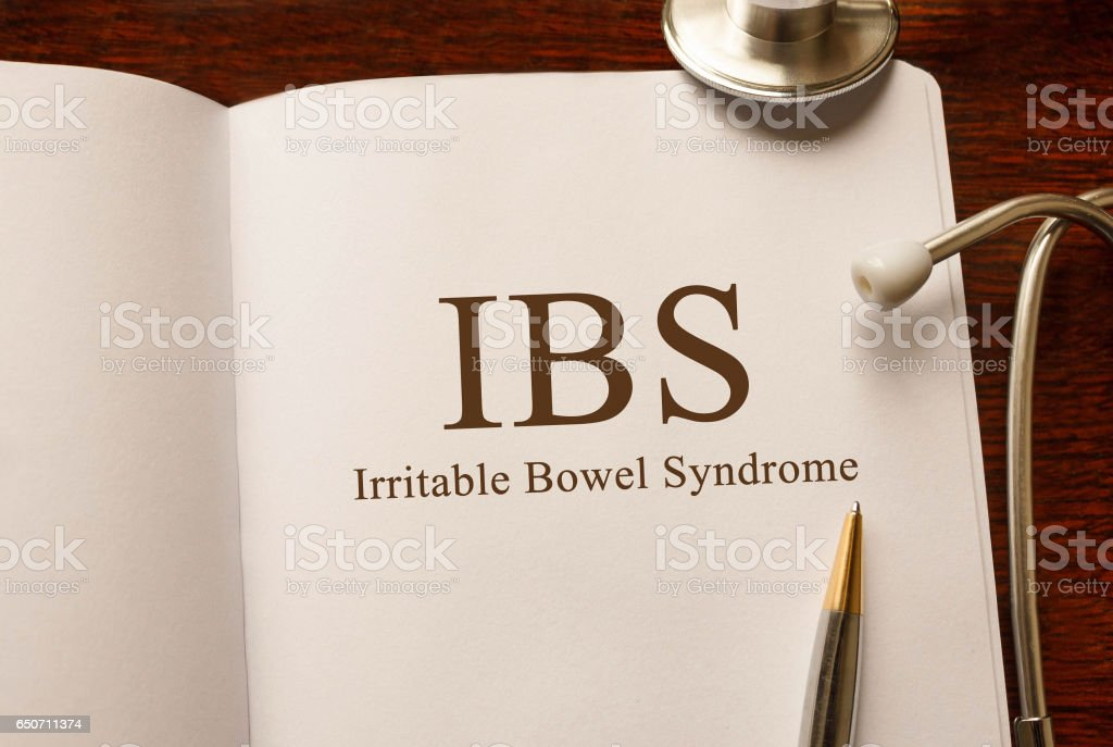 Page with IBS Irritable Bowel Syndrome on the table with stethoscope, medical concept stock photo