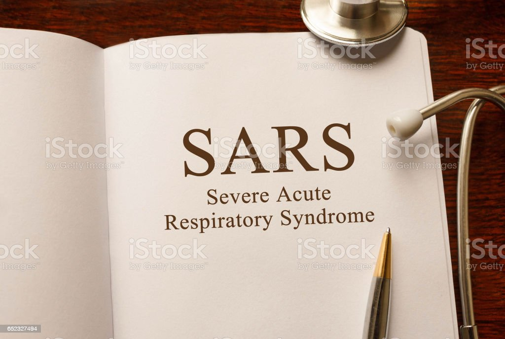 Page with SARS Severe Acute Respiratory Syndrome ,on the table with stethoscope, medical concept stock photo