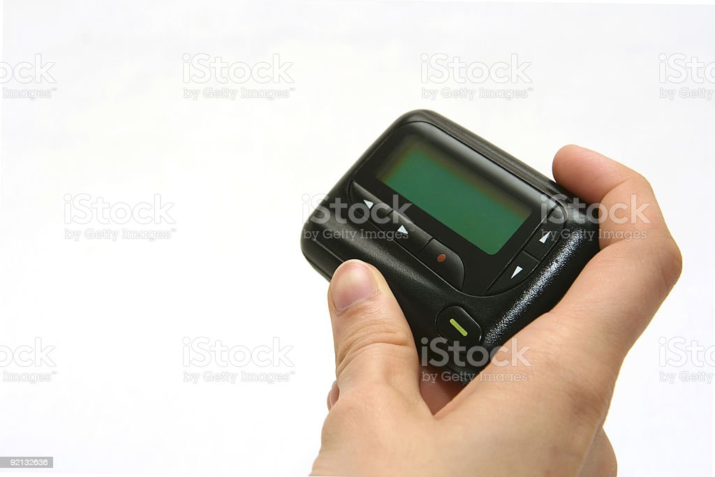 Pager in right hand on white background royalty-free stock photo