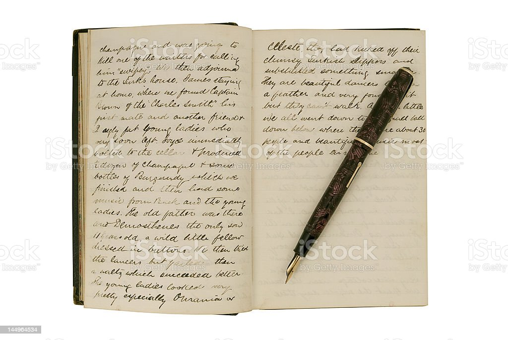Pages in an antique travel diary with fountain pen stock photo