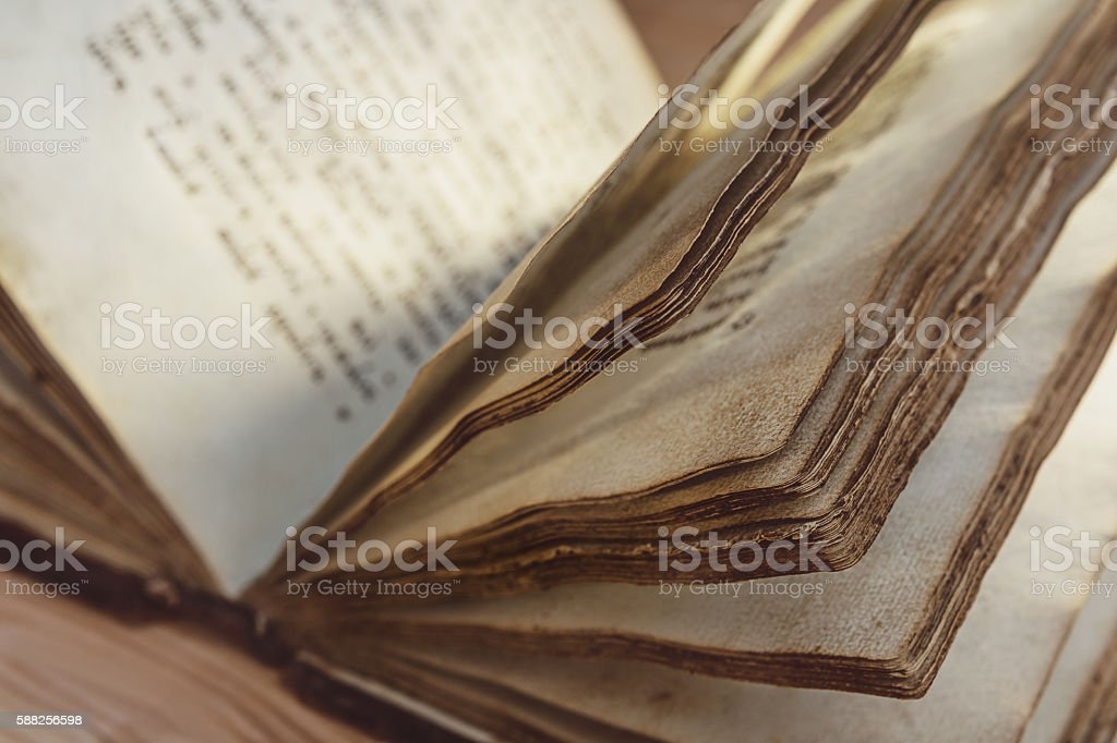 Pages of an open book with text. stock photo