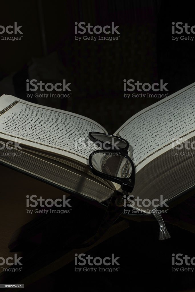 pages of holy koran and geek glasses stock photo