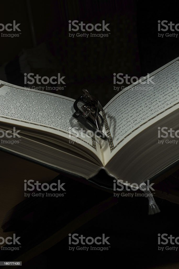 pages of holy koran and geek glasses royalty-free stock photo