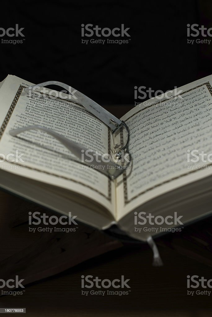 pages of holy koran and glasses royalty-free stock photo