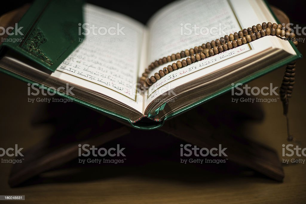 pages of holy koran and rosary at the book stock photo