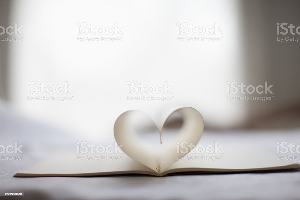 pages of notebook form heart-shape royalty-free stock photo