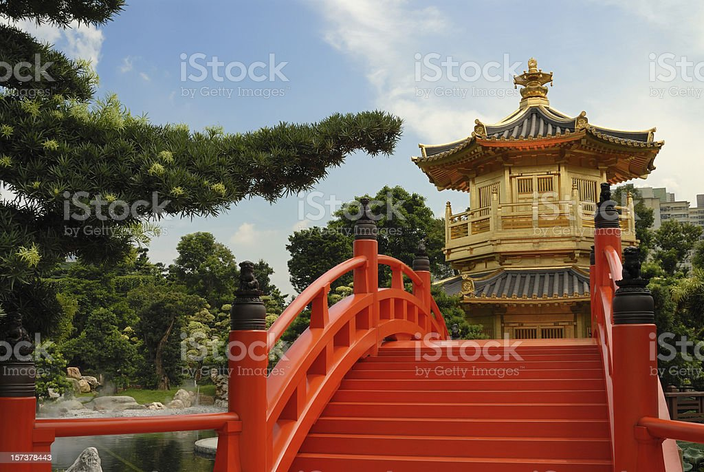 pagoda and red bridge in chinese garden stock photo