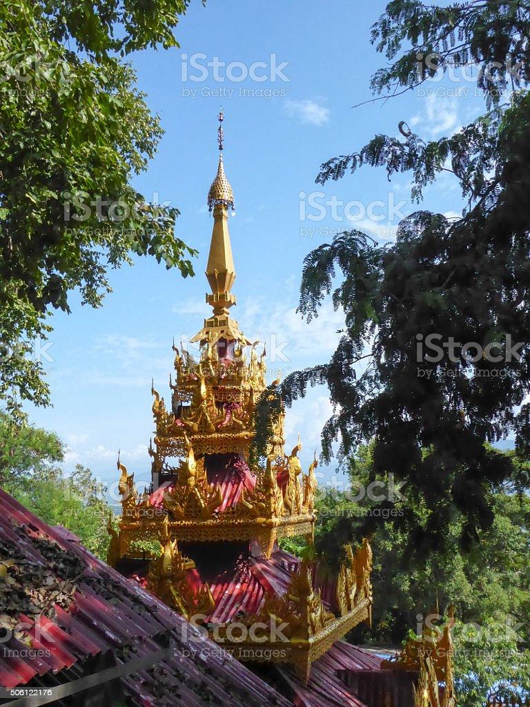 Pagoda Top Seen Through Green Trees stock photo