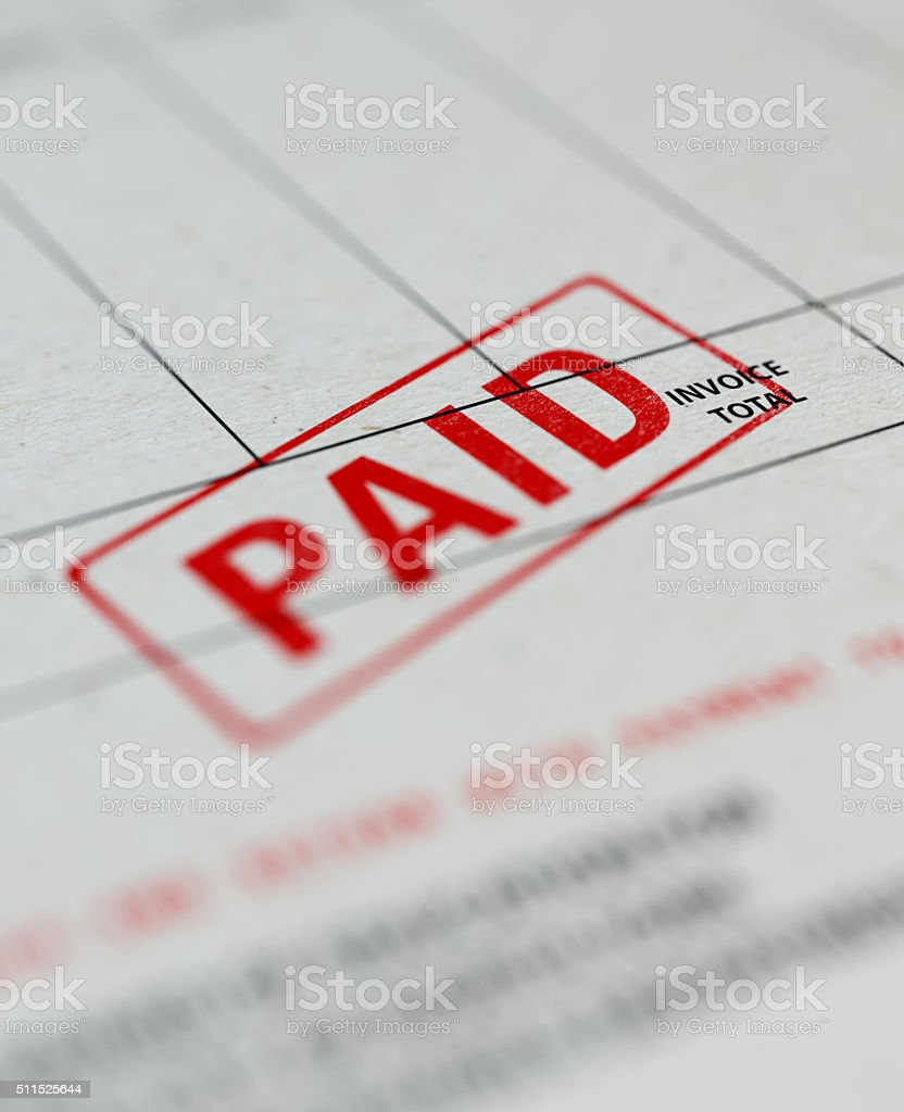 Paid Invoice With Selective Focus stock photo