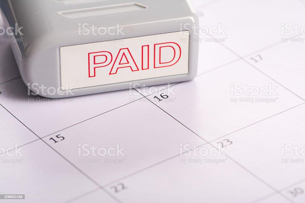Paid Stamp on Calendar stock photo