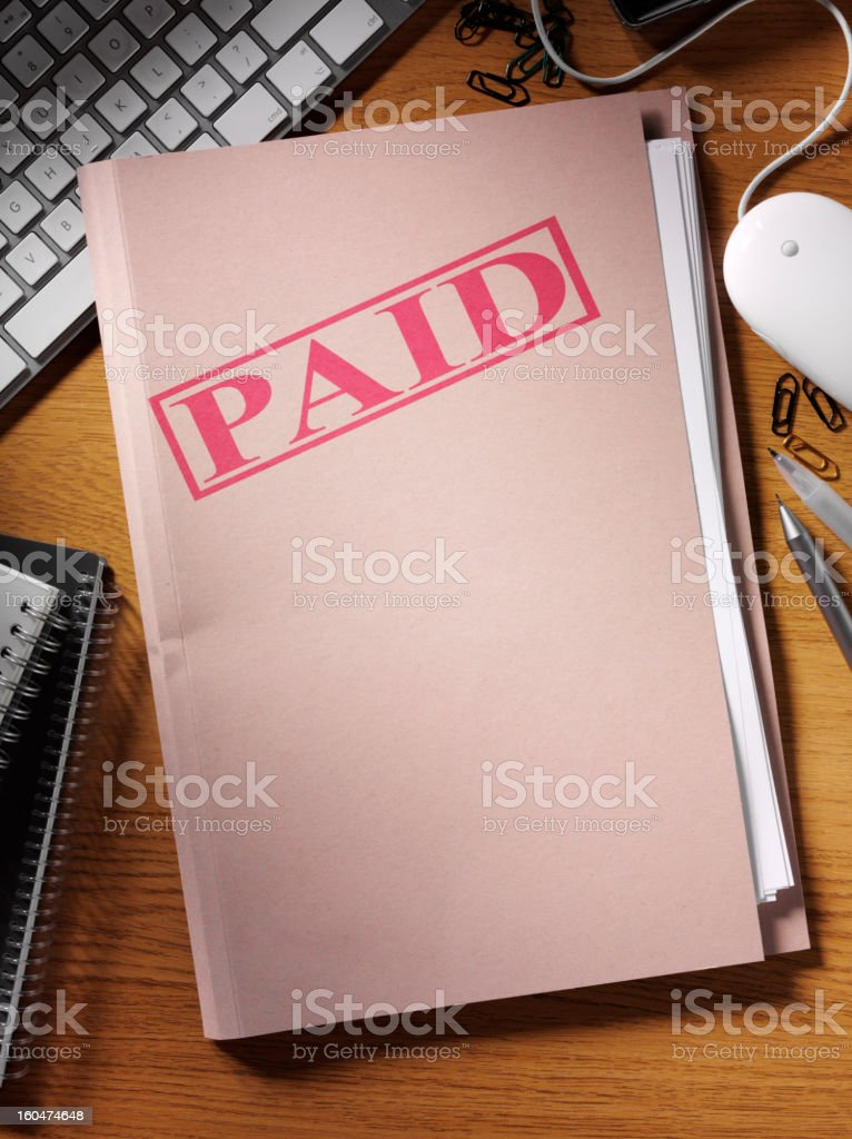 Paid Stamped on a File stock photo
