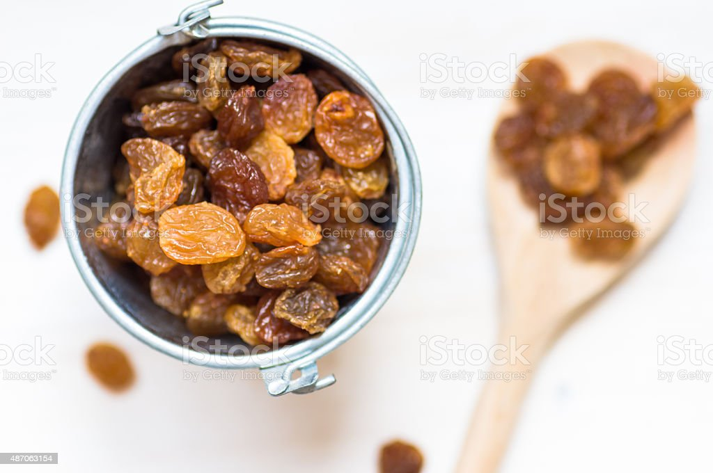 Pails with raisins on the table stock photo