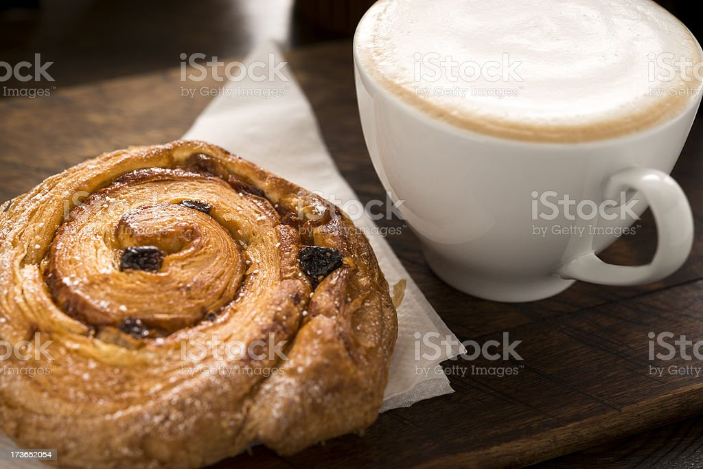 Pain aux raisin with Cappuccino stock photo